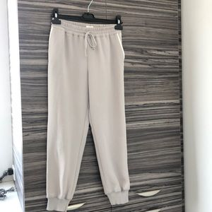Wilfred joggers with white lines on the side